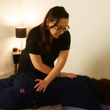 Therapist massaging a patient