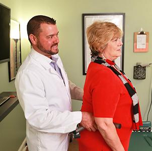 Dr. Aldrich with a patient