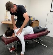 Dr. Barry adjusting a patient