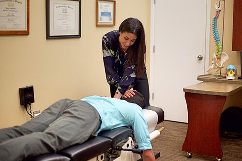 Dr. Shara adjusts a patient