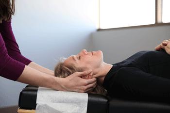 Farmington Chiropractor Dr. Melissa Agnew adjusting patient