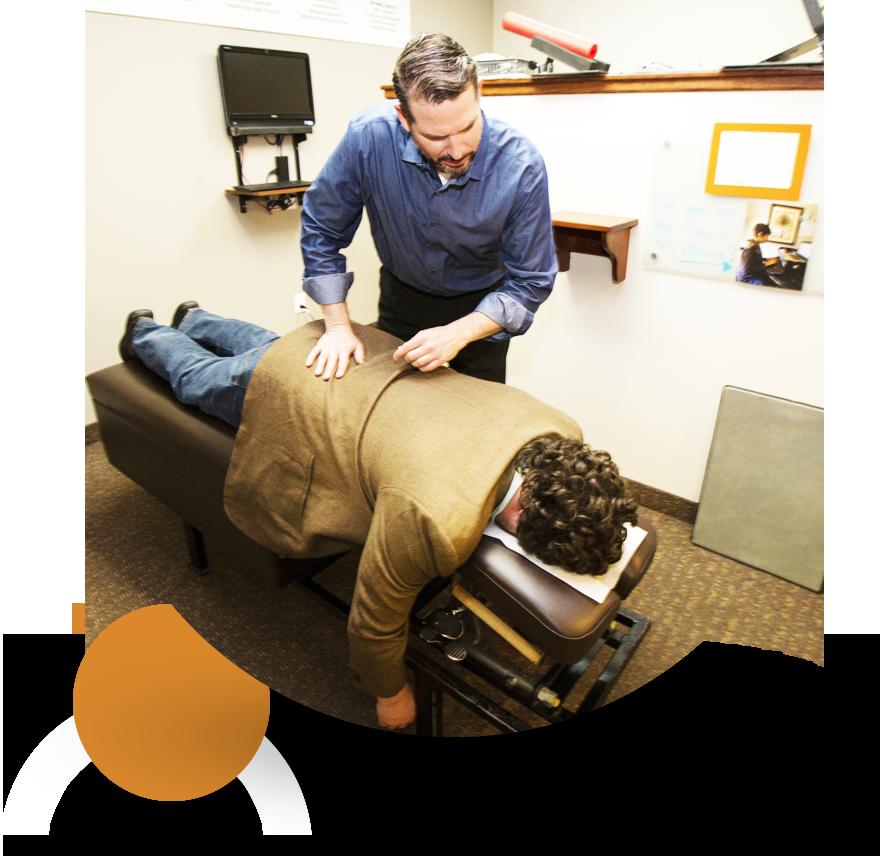 Dr. Mark adjusting patient
