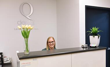 Smiling receptionist at Q Dental Bulimba