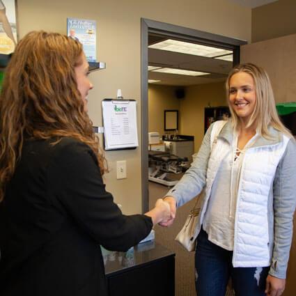 Handshake with patient