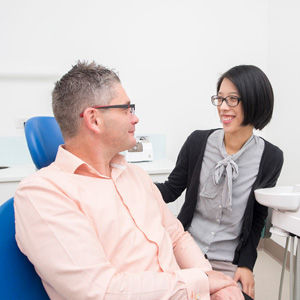A new patient patient at Flagsmile Dental put at his ease by Dr Ann Chen