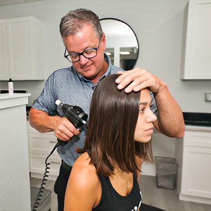 doctor Lee treating patients neck