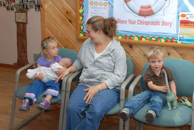Family in waiting room at Branchville Family Chiropractic