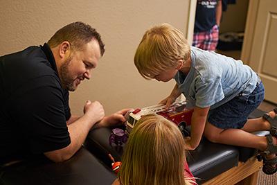 Dr. Justin Turner adjusts children