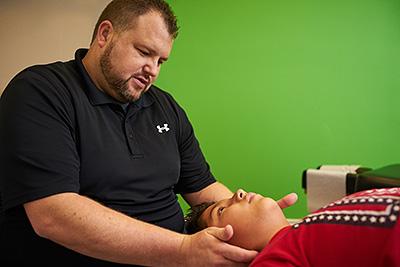 Dr. Turner adjusts a child patient