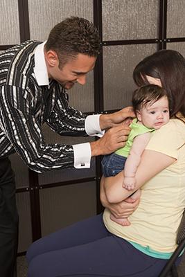 Dr Marco Bouchard adjusting baby