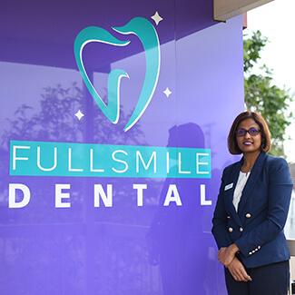 Dentist Acacia Ridge, Dr. Rangi with Sign