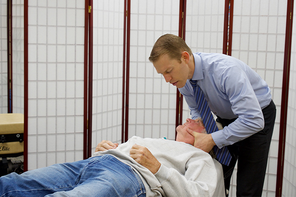 Cervical adjustment by Chiropractor Chippewa