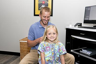 Examination by Chiropractor Oswego, Dr. Garrett