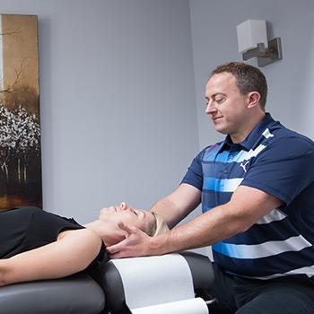Dr. Brian adjusting a patient