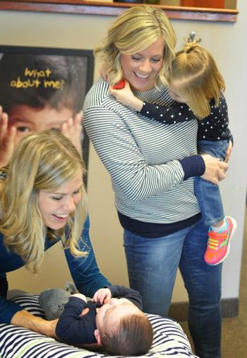 Dr. Jen adjusting a baby.
