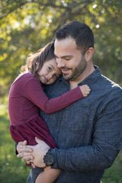 Dr. Dinkel holding his daughter, Gracelyn