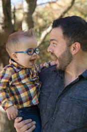 Dr. Dinkel holding his son, Roman