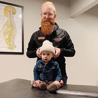 Dr. Spencer adjusting an infant
