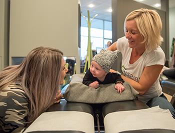 Dr. Lisa adjusting a patient