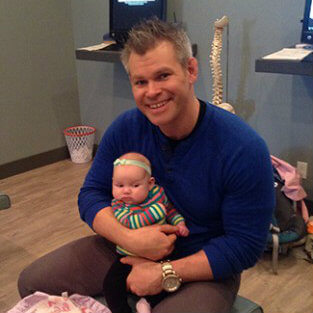 Dr. Rob with a baby patient
