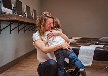 Dr. Lisa hugging little girl
