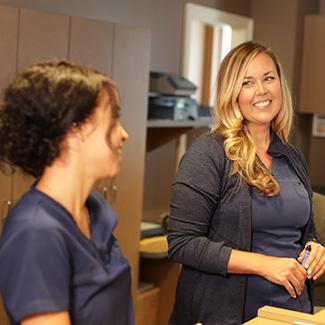 Assitants smiling at front desk