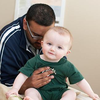 Dr. Dave adjusting baby boy