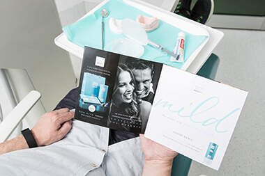 Patient reading Brochure for Teeth Whitening