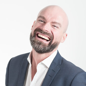 Man with complete sets of straight white teeth