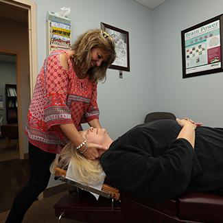 Dr. Wendy adjusting patient