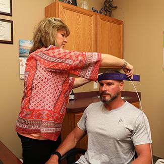 Dr. Wendy preparing patient for biofeedback
