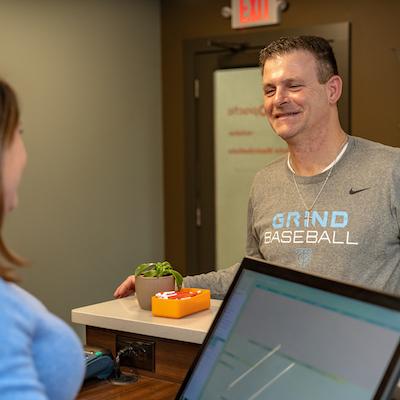 Man Smiling Reception Desk