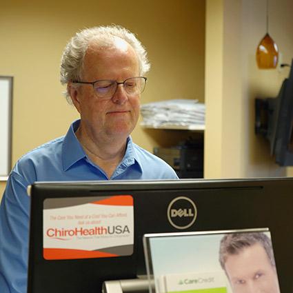 Dr. Whalen at computer