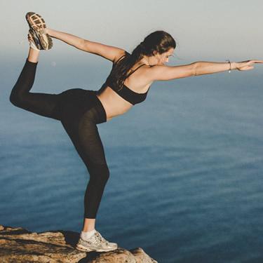 Woman at peak flexible