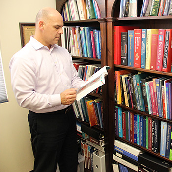 Dr. Palazzo reading research