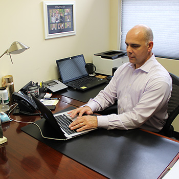 Dr. Palazzo on his computer