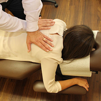 Hands on patient's back