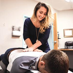 Doctor adjusting patient