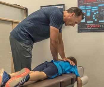Dr. Gray adjusting boy