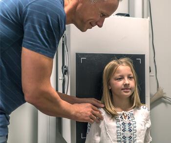 Dr. Gray xraying child