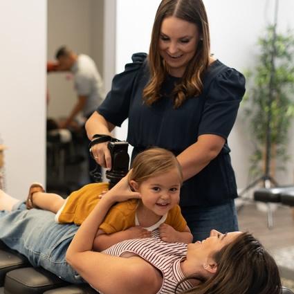 Dr Katrina djusting little smiling girl