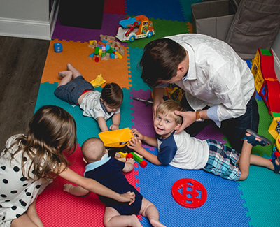 Chiropractor adjusting a child