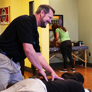 Dr. Josh Adjusting Patient's back