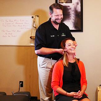 Dr. Josh adjusting neck