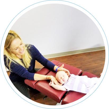 Dr. Senz adjusting a baby