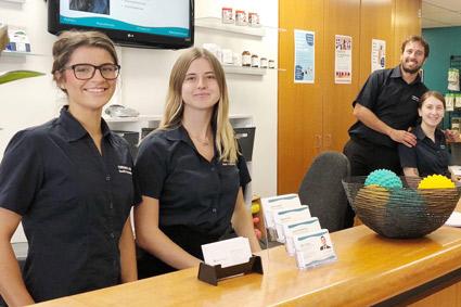 smiling-team-at-front-desk