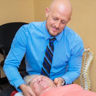 Dr. Scott adjusting female neck