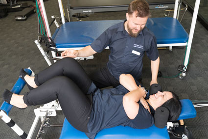 Physiotherapist educating patient