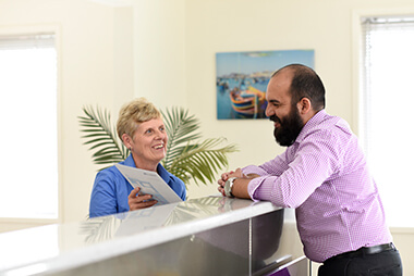 Staff greeting new patient at desk