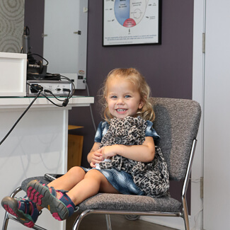 Little girl sitting in waiting area